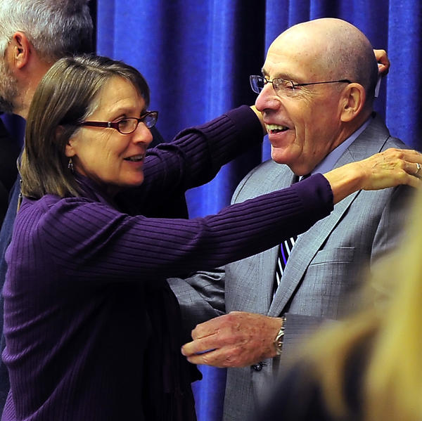 Carole Lafferman-Fitzwater, left, embraces Paul Bailey on Monday during a program at E. Russell Hicks Middle School recognizing the service of Washington County Public Schools' employees. Lafferman-Fitzwater is a 35-year employee who is currently the special education case manager at Washington County Technical High School. Bailey, a school board member, was Lafferman-Fitzwater's first principal when she was hired in 1977 at Smithsburg Middle School. Sharon Barnhart and Joanne Jackson were recognized for 45 years in the school system and five others were honored for 40 years of service.