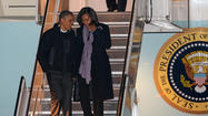 Obama returns to Chicago as voters head to polls