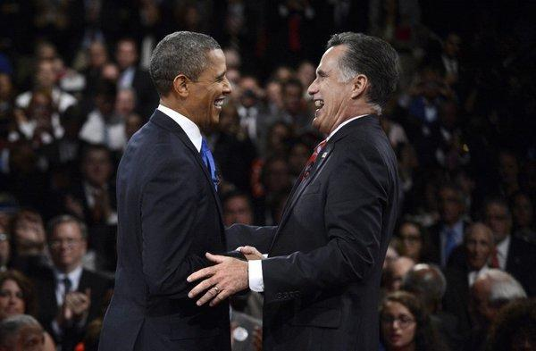 President Obama and Republican presidential nominee Mitt Romney laugh at the conclusion of the third presidential debate at Lynn University in Boca Raton, Fla.