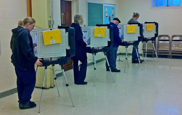 Voters occupy four voting machines at Emmanuel United Methodist Church in Hagerstown on Tuesday morning.