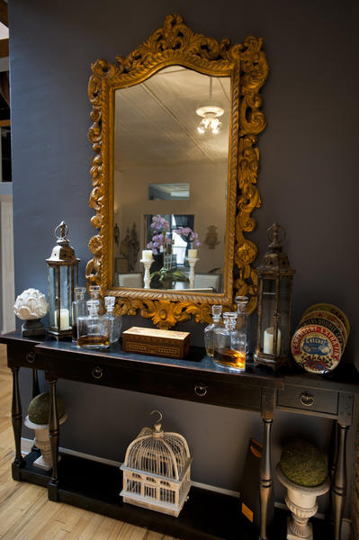 The bar, with a gold mirror purchased from an antique shop.