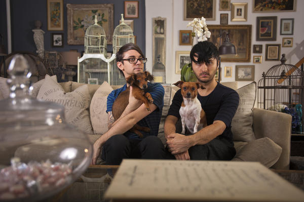 Christian Siriano (left) and Brad Walsh, with their dogs, Bear and Topper.