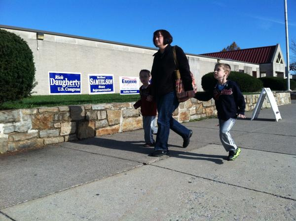 Michelle Fenstermacher arrives to vote at East Hills Middle School in Bethlehem Township on Tuesday morning with twins Zachary and Alex, 5.