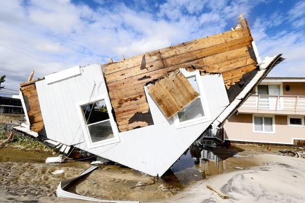 Part of a home rests upside-down in Seaside Heights, N.J. on Oct. 31 after superstorm Sandy made landfall in New Jersey. The rest of the home sat away from its original spot and in the middle of a street.