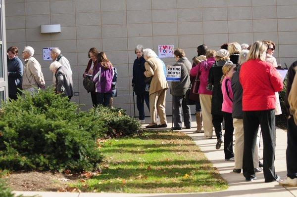 People in line at Bristow Middle School reported more than an hour's wait to vote Tuesday morning.