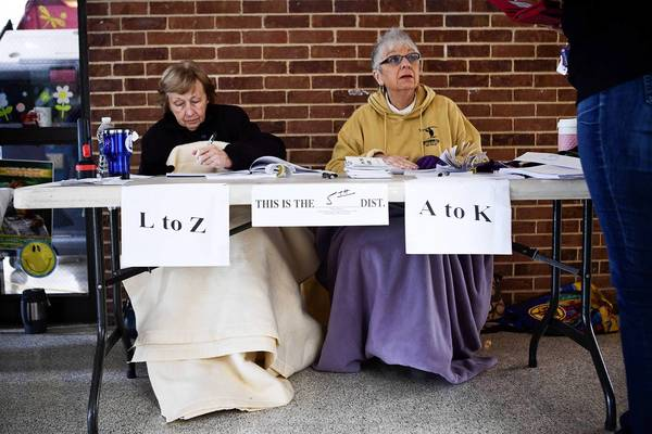 Election Board workers Ann Marut, left, and Phyllis Gubitosi wrap themselves in blankets to keep warm while working at Silver Bay Elementary School in Toms River, New Jersey. The Elementary school, which usually hosts voting for two districts, accommodated voting for seven districts today, due damage caused by Superstorm Sandy. The entire voting system at the school is also run off generators.