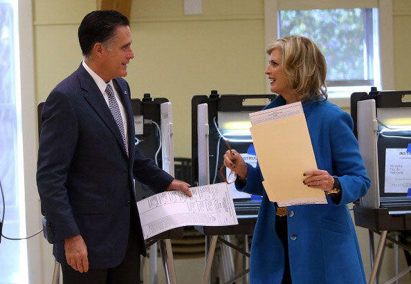 Republican presidential candidate, former Massachusetts Gov. Mitt Romney (L) and his wife Ann Romney talk after filling out their ballots at on November 6, 2012 in Belmont, Massachusetts.