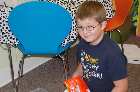 Bate Middle School sixthgrader Caleb Campbell collects Halloween candy for classmates Eli Gooch and Ben Harper, who were injured last week when they were struck by an SUV as they were walking home from school.