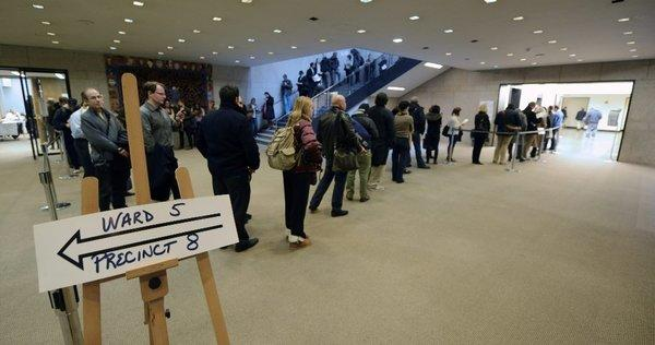 A long line to vote forms Tuesday morning in the main Boston public library.