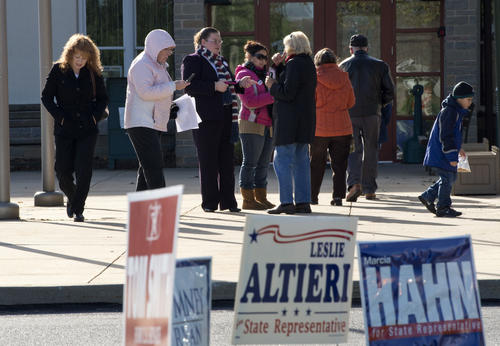 Campaign workers talk to voters outside the Bethlehem Township Municipal building on Tuesday morning.
