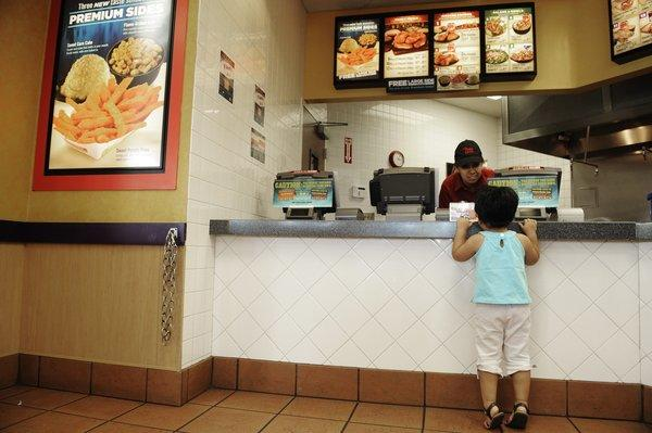 Marrylin Rabadan asks for a packet of sauce during a visit to an El Pollo Loco restaurant in Santa Ana.