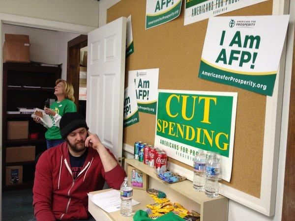Scott Jackson, 30, calls voters at an election day phone bank run by Americans for Prosperity in Virginia.