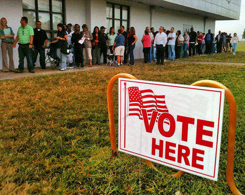 Long line of voters winds around the Pines Recreation Center on Pines Blvd and McArthur Plwy on election day as people wait patiently for their turn to vote for president Tuesday morning.