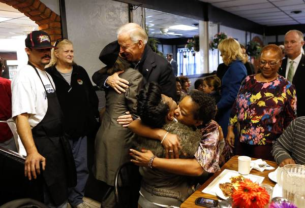 Vice President Joe Biden hugs a woman during a visit to a restaurant in Cleveland.