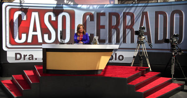 "On ""Caso Cerrado,"" Ana Maria Polo doesn't don any dour black robe but instead sports brightly-colored attire."