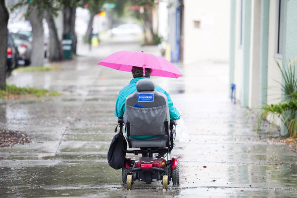 A woman uses a sticker on her motorized wheelchair to make her pro-Obama statement in rainy St. Petersburg, Fla.