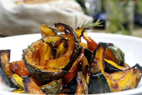 Roasted kabocha squash with a sprig of rosemary.