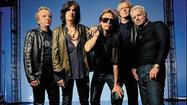 "<span style=""font-size: small;"">Boston's Aerosmith enjoyed a home field advantage of sorts on Monday when they hosted a huge street party in front of their old apartment at 1325 Commonwealth Ave. in Boston. Tens of thousands turned out to rock out at the now historic landmark to celebrate the release today of the Bean Town hero's album Music From Another Dimension, while the band took the opportunity to encourage everyone to do their civic duty and vote today. Aerosmith's eight-song set included classic cuts ""Train Kept A Rollin"" and ""Movin' Out"" as well as brand new tunes ""Lover A Lot"" and ""Oh Yeah.""</span>"