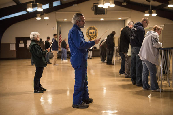 People wait their turn as others vote at the United Auto Workers Local 1250 on Tuesday in Cleveland.