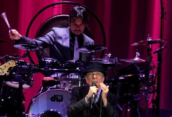 Leonard Cohen, whose band includes Rafael Gayol on percussion, played nearly 30 songs Monday night at Nokia Theatre in Los Angeles.
