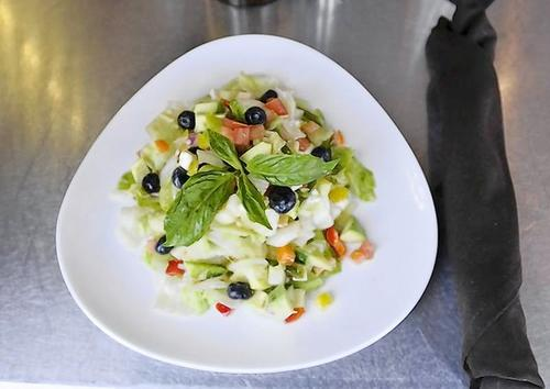 "Helmar's ""Everything but the Kitchen Sink"" chopped salad at Market Grille in Manchester."