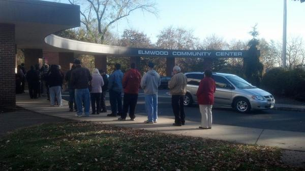 Voters wait in two lines outside the Elmwood Community Center in West Hartford Tuesday morning. A wait of 40 to 50 minutes was reported between 7:30 and 8 a.m.