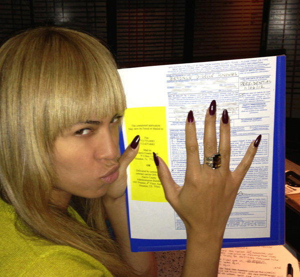 Beyonce holds what appears to be an absentee ballot in a photo published on her Tumblr.