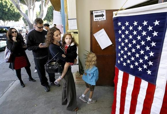 Angela Machala, 37 of Burbank, took her daughters, holding Alani, 4, and Sasha, 6, to watch her vote at the VFW location on Magnolia Ave. in Burbank on Tuesday, Nov. 6, 2012.