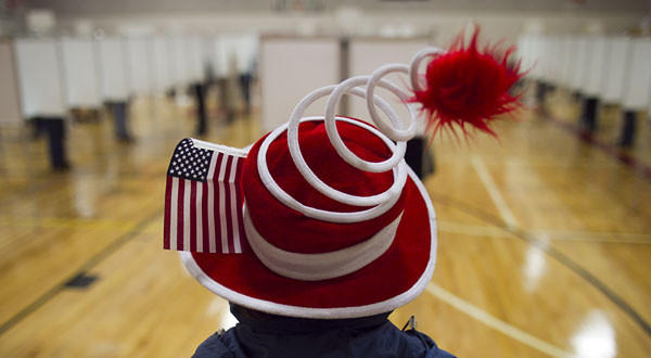Susan Mardas celebrates Election Day by wearing a festive hat Tuesday while waiting for her mother to vote in Scarborough, Maine.