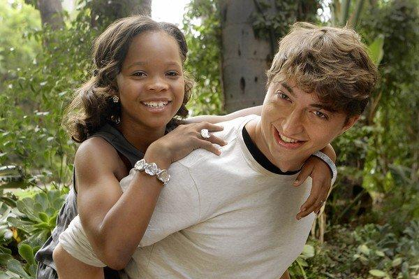 "Director Benh Zeitlin gives his young star Quvenzhane Wallis of ""Beasts of the Southern Wild"" a piggyback ride."