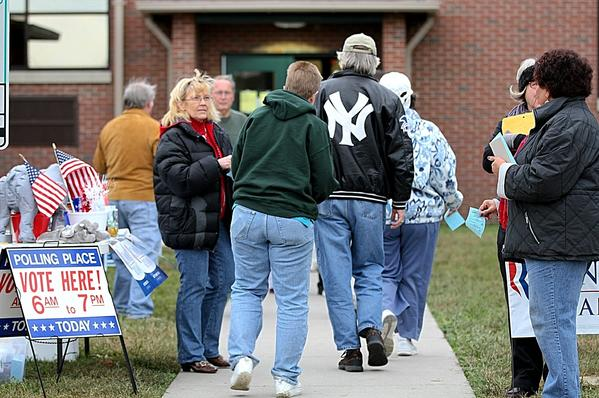 Voters file into the Denbigh Early Childcare Center to vote this afternoon.