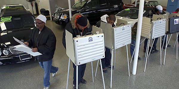 Voters fill out their ballots at Sam's Auto Sales in Chicago.