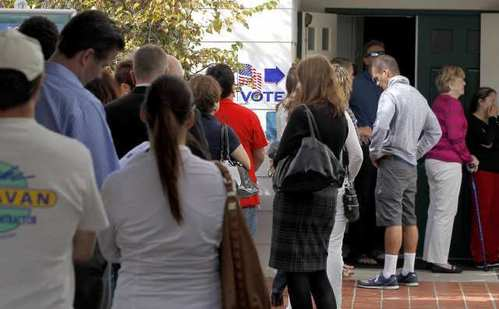 Residents line up to vote at the Congressional Community Church in Corona Del Mar on election day  Tuesday.