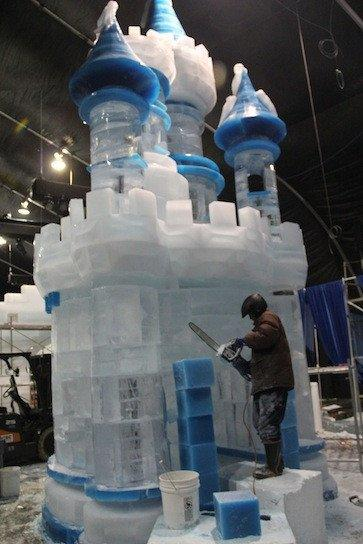 Workers prepare an ice castle for the attraction Chill set to open Nov. 17 next to the Queen Mary.