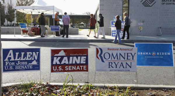 Republican and Democratic signs line the way for voters as they make their way into the Boys and Girls Club to cast their votes Tuesday on Election Day in Charlottesville, Va.