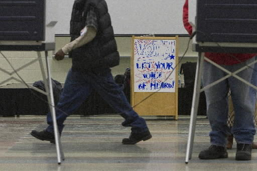 Voters file to polling stations at An Achievable Dream in Newport News on Tuesday evening.