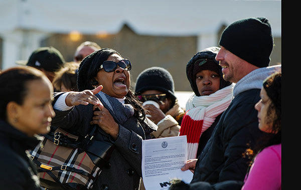 A woman argues with a man while waiting to register for FEMA aid for residents affected by hurricane Sandy in the Queens borough region of the Rockaways in New York November 6, 2012.