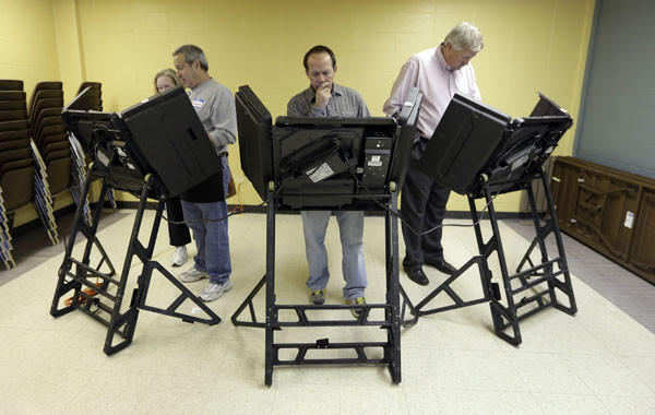Voters cast their ballots in the general election at Kirkwood Community Center in Kirkwood, Mo.