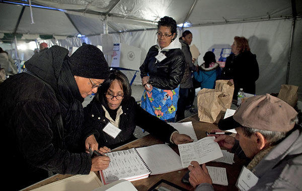 People vote in a tent in the Midland Beach neighborhood of Staten Island in New York City, hard hit by Superstorm Sandy last week.