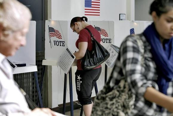 Voters cast their ballots at Wilson Middle School in Glendale on Tuesday, Nov. 6, 2012.