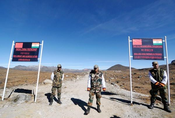 Indian soldiers guard a pass last month on the border with China in Arunachal Pradesh, one of the areas where UFOs have been reported.