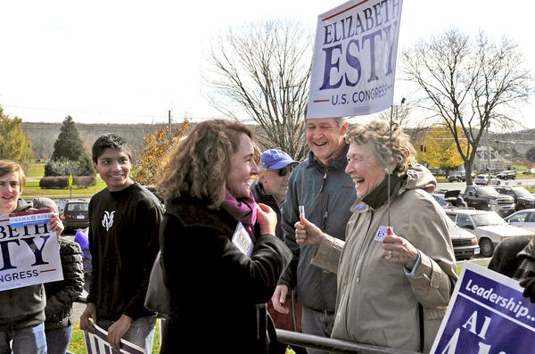 Democratic candidate for U.S. Congress Elizabeth Esty says hello to her mother Mitzi Henderson outside Cheshire High School where Esty voted Tuesday.
