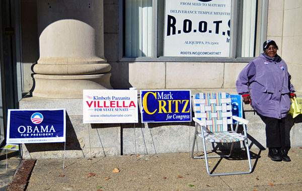Poll worker Ruby Slappy waits to talk to voters outside of the Renaissance Center on Franklin Avenue in Aliquippa, Pa.