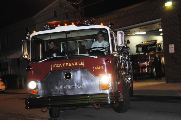 Hooversville fire department Chief James Karashowsky drives the donated fire truck out of the fire hall with Hooversville firefighter Craig Maurer in the passenger seat.