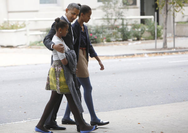 President Obama walks to the White House with his daughters Sasha and Malia earlier this year.