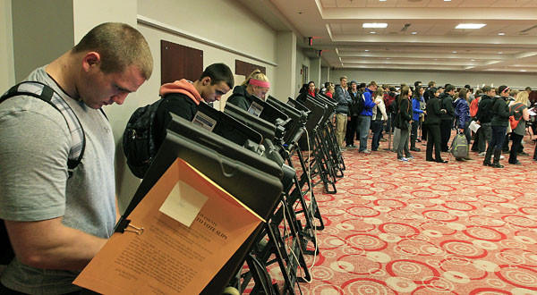 Voters stand in line waiting to cast their ballot at a polling station in Columbus, Ohio.