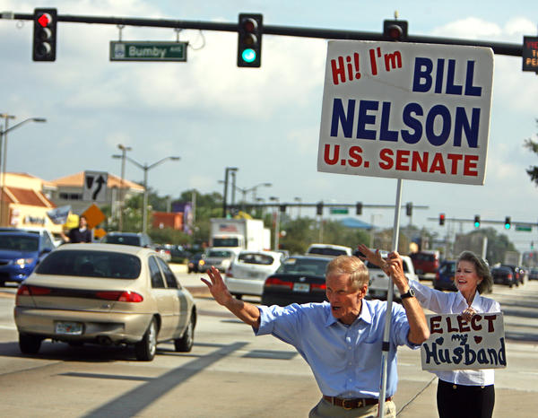 Sen. Bill Nelson (D-Fla.) campaigns with his wife, Grace, in Orlando. Voters elected him to a third term Tuesday.