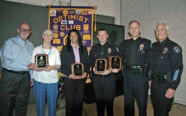 "Magnolia Park Optimist Club President Gary Oseransky, from left, congratulates honorees Kaye Norris, Tania Cooper, John Kaefer and DeWayne ""Doc"" Wolfer along with Interim Police Chief Scott LaChasse."