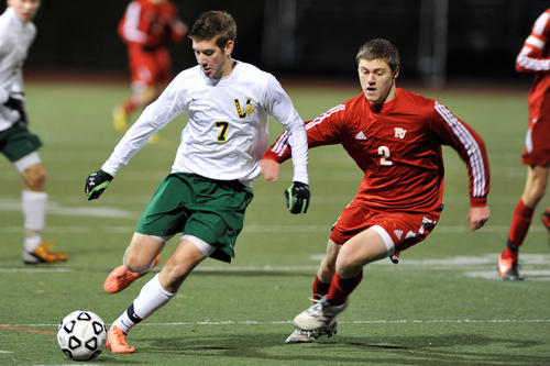 Central Catholic's Cian O'Connell and Pequea Valley's Alex Twardowski chase after the ball. Parkland High School girls played against Neshaminy High School and Central Catholic High School boys played against Pequea Valley High School in a double-header PIAA first round soccer playoff Tuesday, November 6, 2012 at J. Birney Crum Stadium in Allentown, PA.