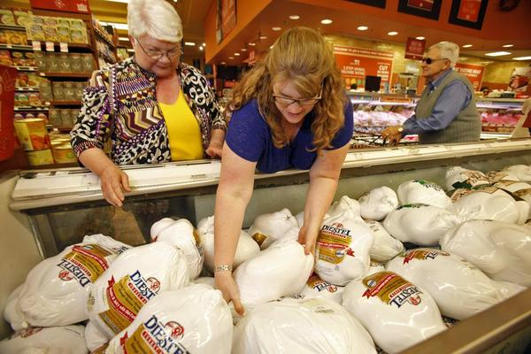 Shoppers seek Thanksgiving turkeys at Whole Foods Market in Virginia last year.